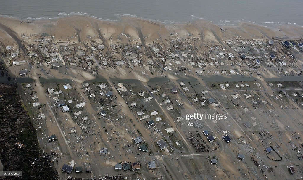 Houses sit among debris after Hurricane Ike made landfall September 14 2008 in Crystal Beach Texas Floodwaters from Hurricane Ike are reportedly as...