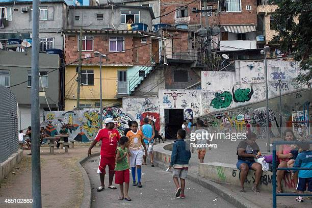Houses stand behind a playground at the Rocinha favela in Rio de Janeiro Brazil on Thursday Aug 20 2015 With joblessness on the rise and abovetarget...
