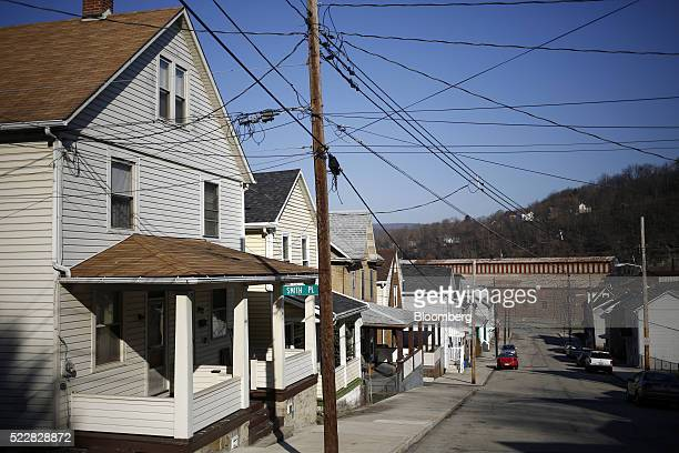 Houses stand near the former Bethlehem Steel Corp plant now occupied by Gautier Steel Ltd in downtown Johnstown Pennsylvania US on Friday April 15...