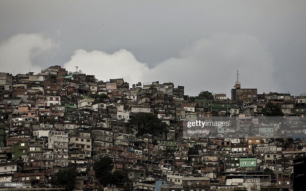 Houses stand on a hill in the Rocinha slum of Rio de Janeiro, Brazil, on Wednesday, Nov. 28, 2012. About 56 percent of the 12 million people who live in slums like Rocinha were considered middle class in 2011, up from 29 percent in 2001, according to a study this year by Instituto Data Popular, a Sao Paulo-based research group. Photographer: Dado Galdieri/Bloomberg via Getty Images
