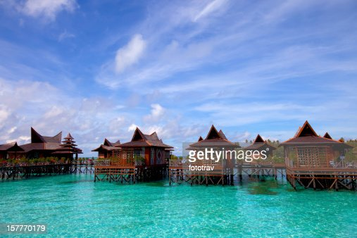 Houses upon stilts in water village on Mabul Island Malaysia