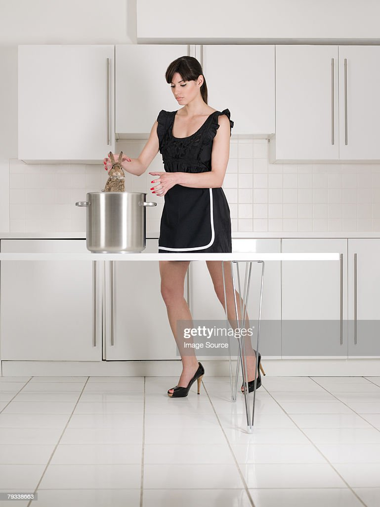 Housewife cooking a rabbit : Stock Photo