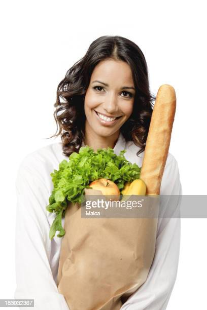 Housewife holding grocery bag