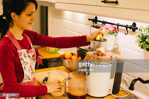 Housewife juicing at the kitchen