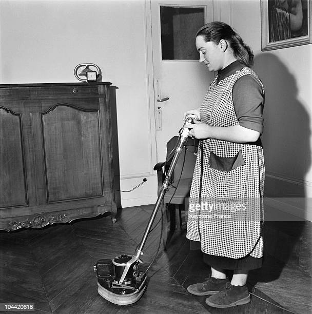 Housewife Polishing The Wooden Floor In The Flat Around 1950