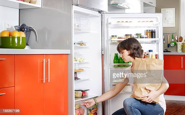 Housewife refrigerator organizing