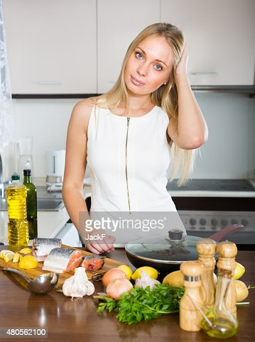 Housewife thinking what to cook for dinner : Stock Photo