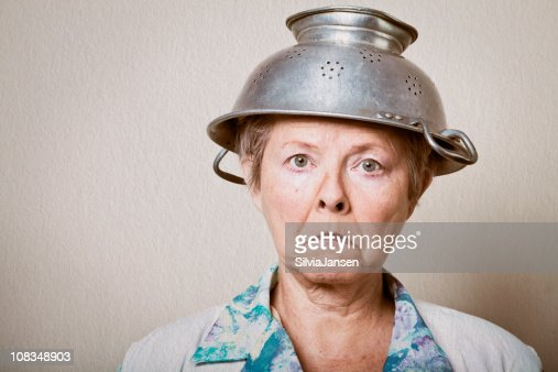 housewife with colander hat : Stock Photo
