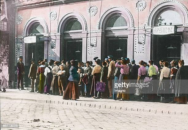 Housewifes line up in front of a pharmacy to buy saccharin Vienna 16th district Handcolored lantern slide Around 1915