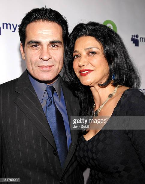 Houshang Touzie and Shohreh Aghdashloo during MySpace Presents Rock for Darfur Party Benefiting Oxfam America at Private Estate in Beverly Hills...