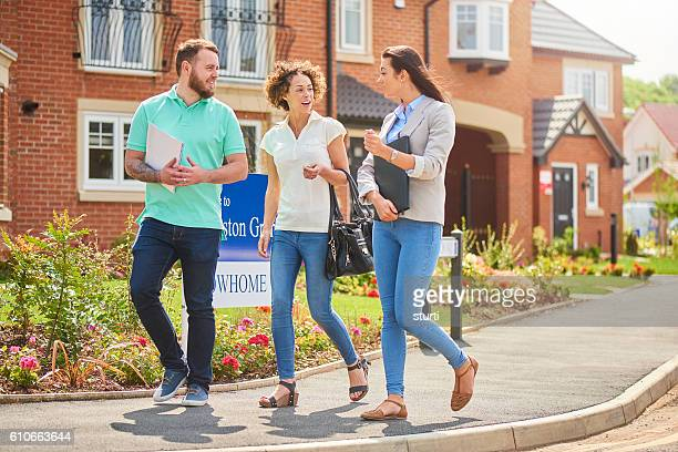 housing saleswoman with couple