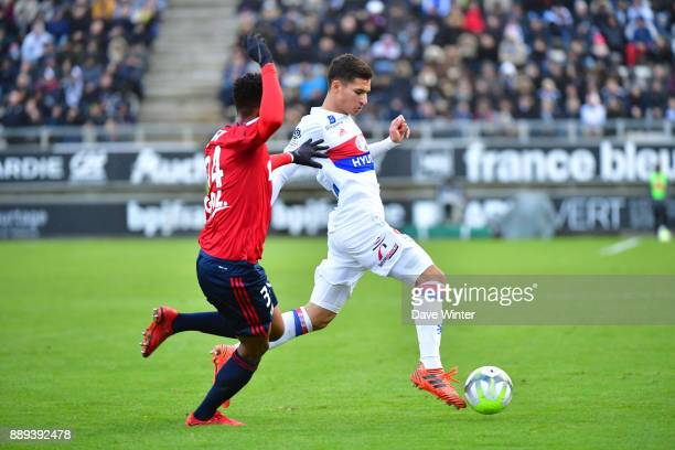 Houssem Aouar of Lyon and Bongani Zungu of Amiens during the Ligue 1 match between Amiens SC and Olympique Lyonnais at Stade de la Licorne on...