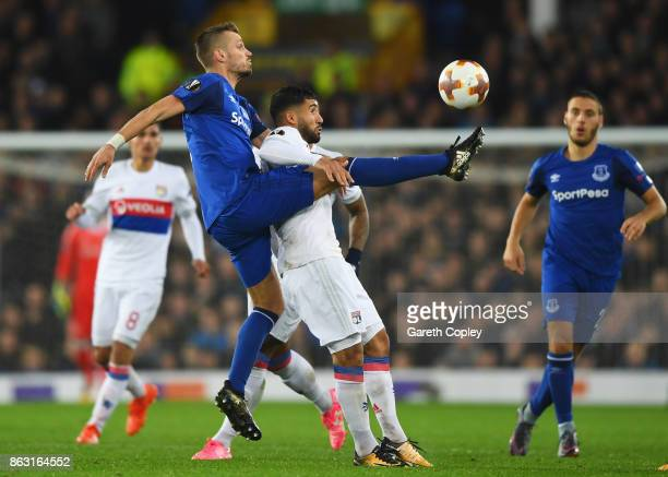 Houssem Aouar of Lyon and Morgan Schneiderlin of Everton battle for the ball during the UEFA Europa League Group E match between Everton FC and...