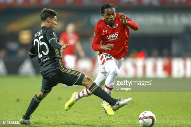 Houssem Aouar of Olympique Lyon Levi Garcia of AZ Alkmaarduring the UEFA Europa League round of 32 match between AZ Alkmaar and Olympique Lyonnais on...