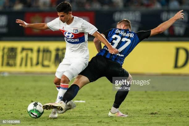 Houssem Aouar of Olympique Lyonnais dribbles past Milan Skriniar during the 2017 International Champions Cup football match between FC Internationale...