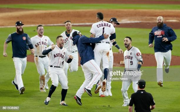 Houston Astros' Carlos Correa and teammates celebrate after they beat the New York Yankees 21 with Correa's walkoff double in an American League...