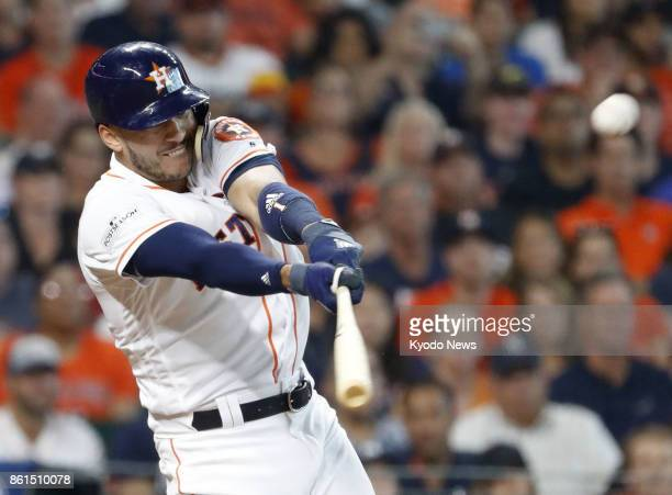 Houston Astros' Carlos Correa hits a home run in the fourth inning of an American League Championship Series game against the New York Yankees at...