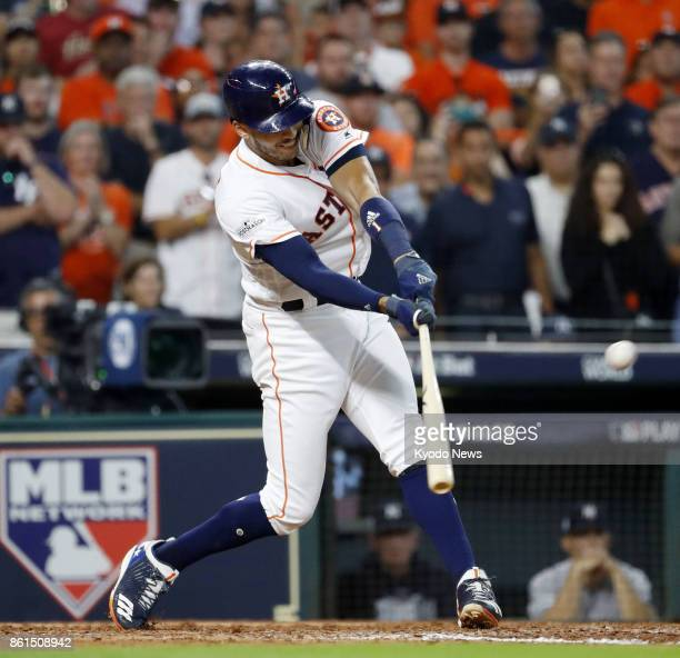 Houston Astros' Carlos Correa hits a walkoff double against the New York Yankees during an American League Championship Series game at Minute Maid...