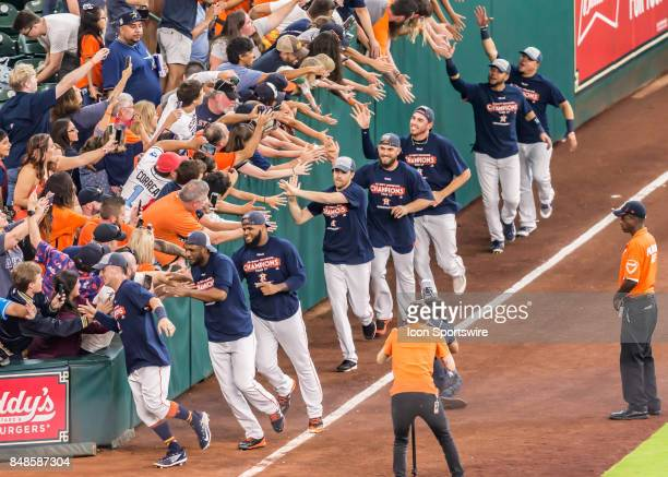 Houston Astros celebrate their AL West Division title with fans during the MLB game between the Seattle Mariners and Houston Astros on September 17...