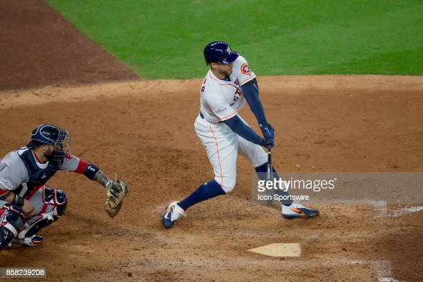 Houston Astros center fielder George Springer hits for a single in the sixth inning during game one of American Division League Series between the...