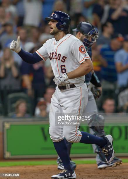 Houston Astros center fielder Jake Marisnick gives the thumbs up to the fans after scoring a home run in the third inning of the MLB game between the...