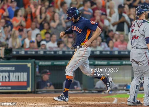 Houston Astros center fielder Jake Marisnick taps home plate in the seventh inning of the MLB between the Minnesota Twins and Houston Astros on July...