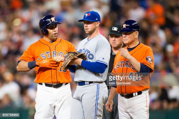 Houston Astros designated hitter Carlos Beltran and Toronto Blue Jays first baseman Justin Smoak talking at first base in the fourth inning of a MLB...