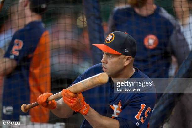 Houston Astros designated hitter Carlos Beltran puts down a bunt inside the batting cage shows during Houston Astros batting practice prior to a MLB...