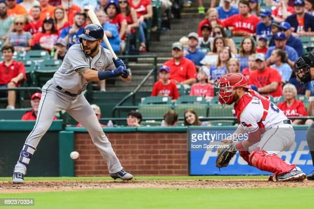 Houston Astros first baseman Marwin Gonzalez dodges an inside fastball as Texas Rangers catcher Jonathan Lucroy blocks the baseball during the game...
