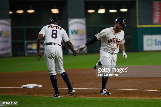 Houston Astros first baseman Tyler White shakes hands with Houston Astros third base coach Gary Pettis after hitting a solo home run in the third...