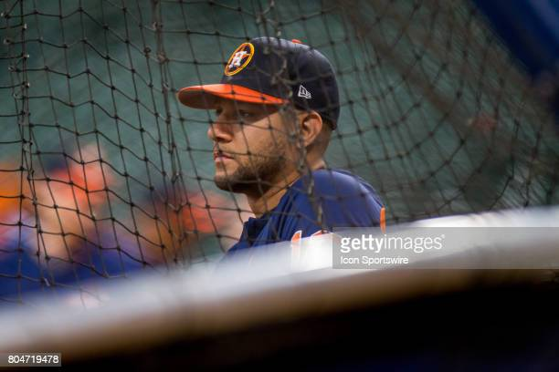 Houston Astros first baseman Yuli Gurriel looks on by the batting cages during batting practice prior to a MLB baseball game between the Houston...
