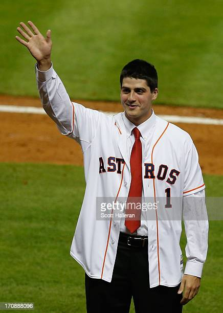 Houston Astros first overall draft pick Mark Appel waves to the crowd on the field after Appel signed with the team prior to the start of the game...