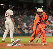 Houston Astros grounds crew dressed as astronauts in celebration of the 1965 Houston Astros during the game against the Los Angeles Angels of Anaheim...
