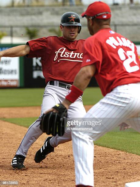Houston Astros infielder Chris Burke slides into third base against the Philadelphia Phillies in a spring training game March 7 2005 in Clearwater...
