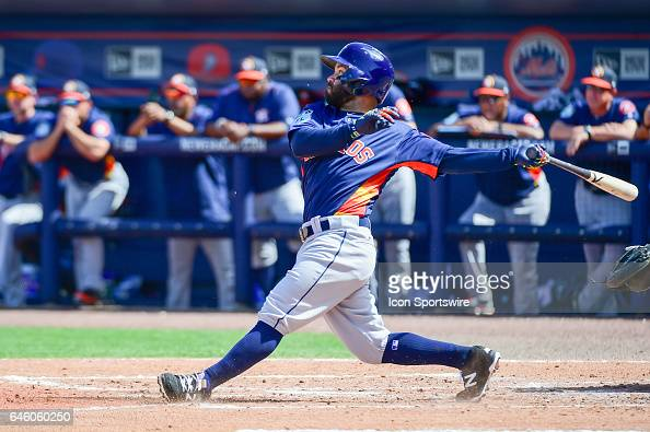 Houston Astros infielder Jose Altuve watches his hit sail out of the infield during a Spring Training game between the Houston Astros and New York...