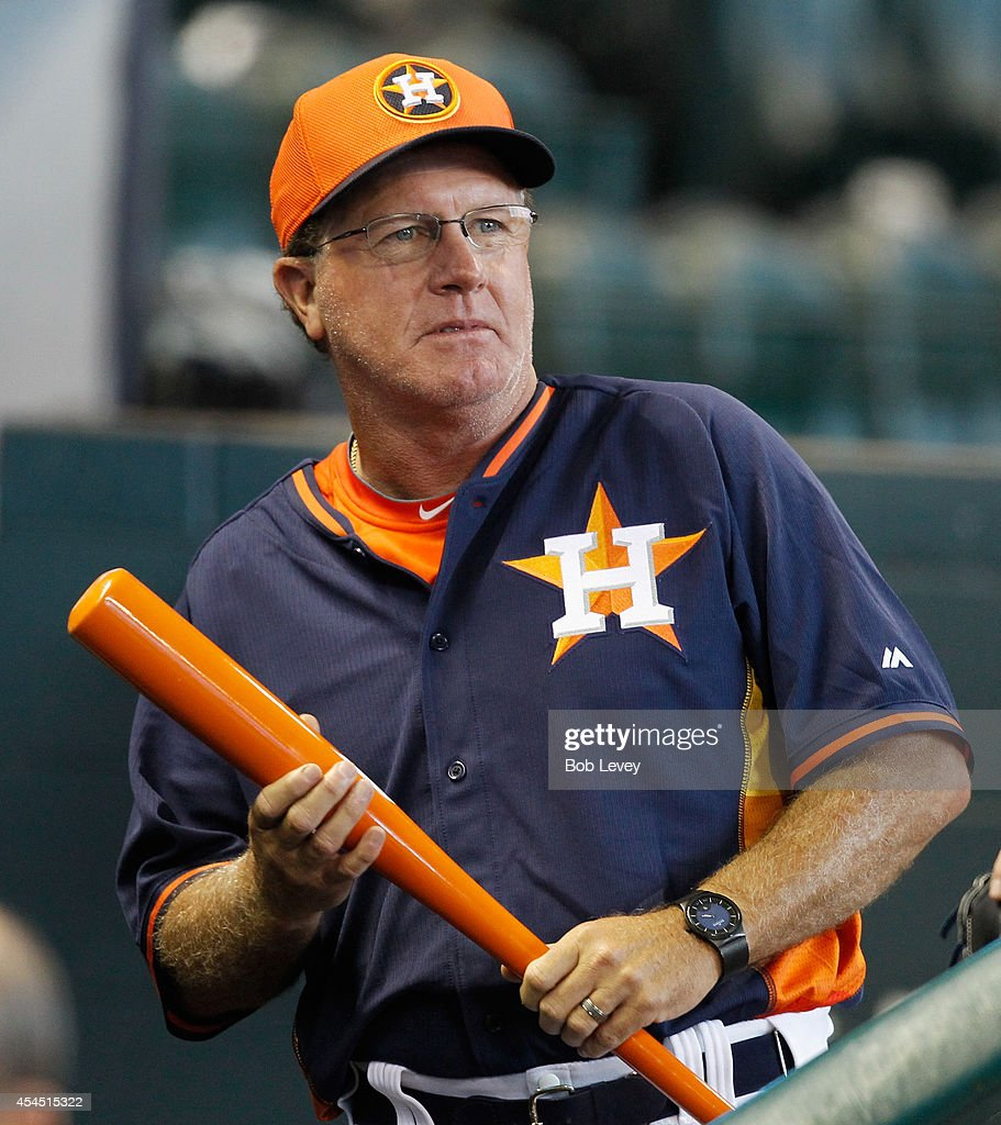 Houston Astros interim manager Tom Lawless talks with the media in the dugout before a baseball game against the Los Angeles Angels at Minute Maid Park on September 2, 2014 in Houston, Texas.