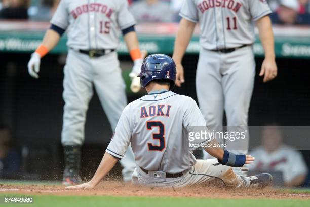 Houston Astros Left field Nori Aoki slides into home plate to score a run during the fifth inning of the Major League Baseball game between the...
