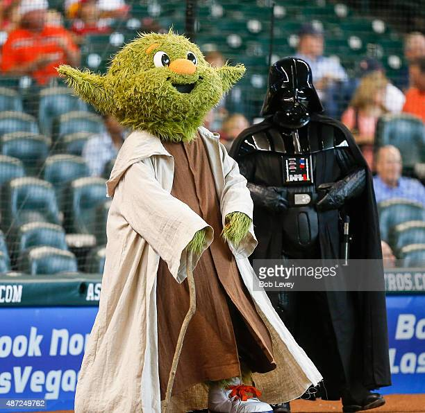 Houston Astros macot Orbit dressed as Yoda and Darth Vader on Star Wars Days at Minute Maid Park on September 6 2015 in Houston Texas