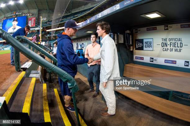 Houston Astros manager AJ Hinch shakes hands RHP Forrest Whitley OF Kyle Tucker looks on prior to an MLB game between the Houston Astros and the Los...