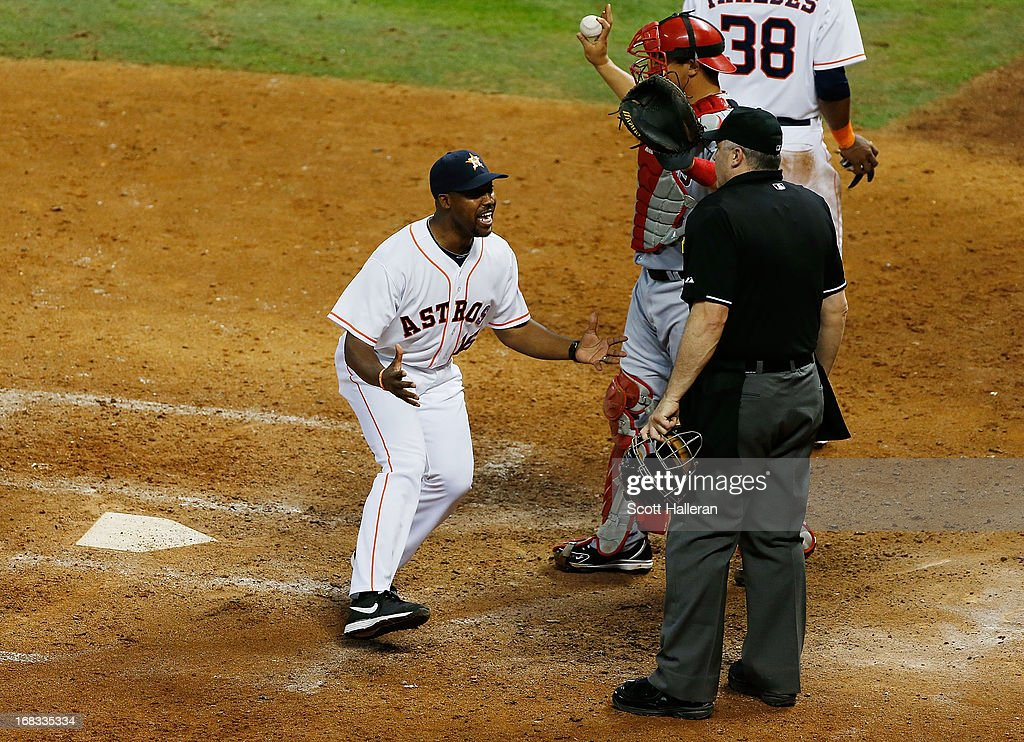 Houston Astros manager Bo Porter #18 argues a play at the plate with umpire Bill Welke in the eighth inning during the game against the Los Angeles Angels of Anaheim at Minute Maid Park on May 8, 2013 in Houston, Texas.