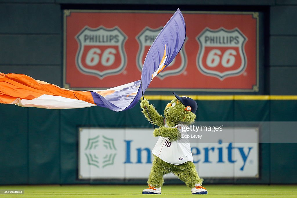 Houston Astros mascot Orbit waves a flag in the outfield after the Houston Astros defeat the Kansas City Royals in game three of the American League...