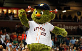 Houston Astros mascot Orbit waves to fans in the seventh inning of their game against the San Francisco Giantsqq at Minute Maid Park on May 13 2015...
