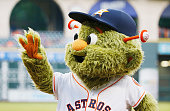 Houston Astros mascot Orbit waves to fans on the field before the start of their game against the Baltimore Orioles at Minute Maid Park on June 3...