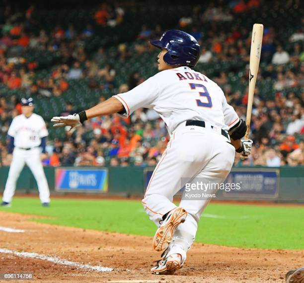 Houston Astros outfielder Norichika Aoki singles during the eighth inning in a 132 win over the Texas Rangers at Minute Maid Park in Houston on June...