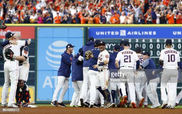 Houston Astros players celebrate after a 40 victory over the New York Yankees in Game 7 of the American League Championship Series at Minute Maid...
