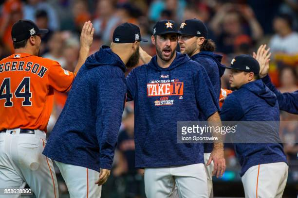 Houston Astros players shakes hands with teammates after game two of American Division League Series between the Houston Astros and the Boston Red...