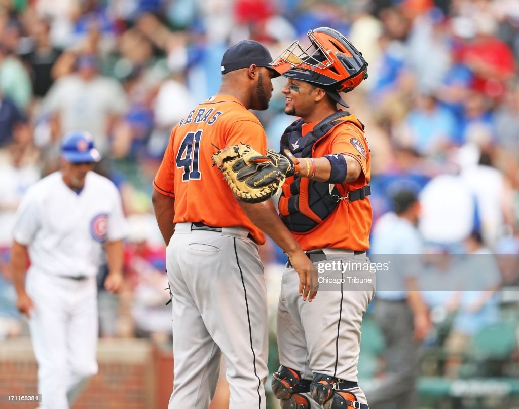 Houston Astros relief pitcher Jose Veras (41) hugs catcher Carlos Corporan after the last out in a 4-3 win against the Chicago Cubs at Wrigley Field in Chicago, Illinois, on Saturday, June 22, 2013.