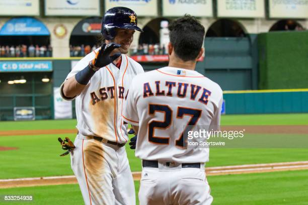 Houston Astros right fielder Josh Reddick celebrates with Houston Astros second baseman Jose Altuve after hitting a homerun in the eighth inning of a...