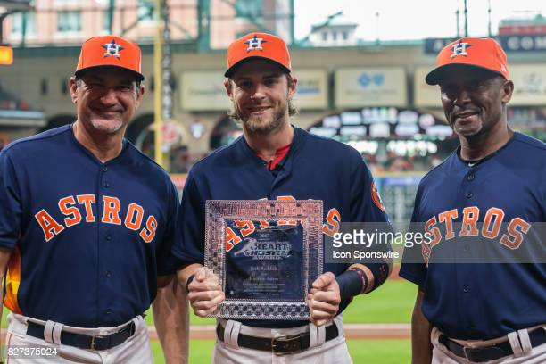 Houston Astros right fielder Josh Reddick is flanked by Houston Astros hitting coach Dave Hudgens and Houston Astros third base coach Gary Pettis...
