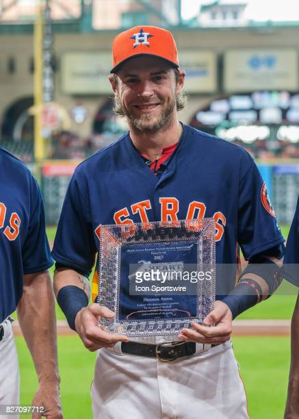 Houston Astros right fielder Josh Reddick receives the Heart Hustle award from the MLB Players Alumni Association during the MLB game between the...